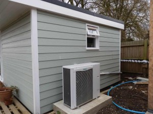 heat pump installation in an outhouse